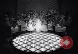 Image of dancers in night club Paris France, 1956, second 18 stock footage video 65675032323