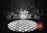 Image of dancers in night club Paris France, 1956, second 20 stock footage video 65675032323