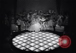 Image of dancers in night club Paris France, 1956, second 21 stock footage video 65675032323