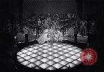 Image of dancers in night club Paris France, 1956, second 22 stock footage video 65675032323
