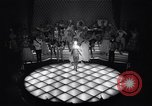 Image of dancers in night club Paris France, 1956, second 23 stock footage video 65675032323