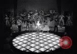 Image of dancers in night club Paris France, 1956, second 24 stock footage video 65675032323