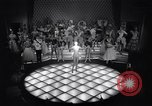 Image of dancers in night club Paris France, 1956, second 25 stock footage video 65675032323