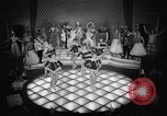 Image of dancers in night club Paris France, 1956, second 31 stock footage video 65675032323