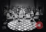 Image of dancers in night club Paris France, 1956, second 32 stock footage video 65675032323
