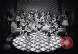 Image of dancers in night club Paris France, 1956, second 33 stock footage video 65675032323