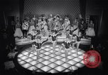Image of dancers in night club Paris France, 1956, second 34 stock footage video 65675032323