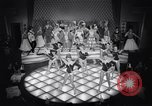 Image of dancers in night club Paris France, 1956, second 36 stock footage video 65675032323