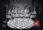 Image of dancers in night club Paris France, 1956, second 38 stock footage video 65675032323