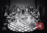 Image of dancers in night club Paris France, 1956, second 42 stock footage video 65675032323
