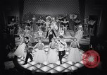 Image of dancers in night club Paris France, 1956, second 55 stock footage video 65675032323