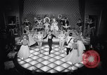 Image of dancers in night club Paris France, 1956, second 59 stock footage video 65675032323