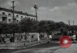 Image of citizens up-keeping the village Podolsk Russia, 1949, second 23 stock footage video 65675032370