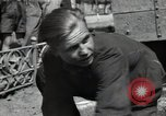 Image of citizens up-keeping the village Podolsk Russia, 1949, second 27 stock footage video 65675032370