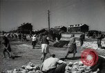 Image of citizens up-keeping the village Podolsk Russia, 1949, second 32 stock footage video 65675032370