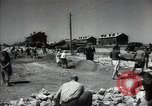 Image of citizens up-keeping the village Podolsk Russia, 1949, second 34 stock footage video 65675032370
