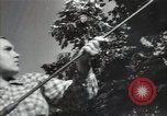 Image of citizens up-keeping the village Podolsk Russia, 1949, second 44 stock footage video 65675032370