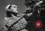 Image of citizens up-keeping the village Podolsk Russia, 1949, second 47 stock footage video 65675032370