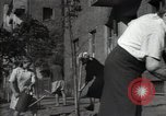 Image of citizens up-keeping the village Podolsk Russia, 1949, second 53 stock footage video 65675032370