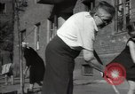 Image of citizens up-keeping the village Podolsk Russia, 1949, second 54 stock footage video 65675032370