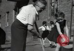 Image of citizens up-keeping the village Podolsk Russia, 1949, second 55 stock footage video 65675032370