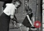 Image of citizens up-keeping the village Podolsk Russia, 1949, second 56 stock footage video 65675032370