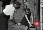 Image of citizens up-keeping the village Podolsk Russia, 1949, second 57 stock footage video 65675032370