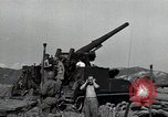 Image of US 24th Infantry soldiers firing from tank United States USA, 1947, second 29 stock footage video 65675032380