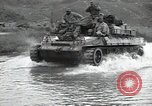Image of US 24th Infantry soldiers firing from tank United States USA, 1947, second 43 stock footage video 65675032380