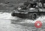 Image of US 24th Infantry soldiers firing from tank United States USA, 1947, second 44 stock footage video 65675032380
