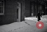 Image of Policeman checking building security United States USA, 1951, second 16 stock footage video 65675032416