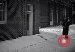 Image of Policeman checking building security United States USA, 1951, second 19 stock footage video 65675032416