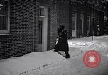 Image of Policeman checking building security United States USA, 1951, second 21 stock footage video 65675032416