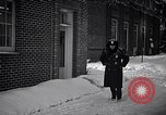 Image of Policeman checking building security United States USA, 1951, second 26 stock footage video 65675032416