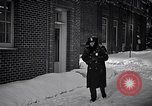 Image of Policeman checking building security United States USA, 1951, second 27 stock footage video 65675032416