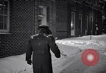 Image of Policeman checking building security United States USA, 1951, second 40 stock footage video 65675032416