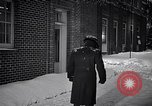 Image of Policeman checking building security United States USA, 1951, second 41 stock footage video 65675032416