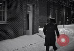 Image of Policeman checking building security United States USA, 1951, second 42 stock footage video 65675032416