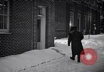 Image of Policeman checking building security United States USA, 1951, second 44 stock footage video 65675032416