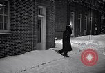 Image of Policeman checking building security United States USA, 1951, second 49 stock footage video 65675032416