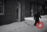 Image of Policeman checking building security United States USA, 1951, second 50 stock footage video 65675032416