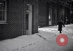 Image of Policeman checking building security United States USA, 1951, second 56 stock footage video 65675032416