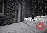 Image of Policeman checking building security United States USA, 1951, second 58 stock footage video 65675032416