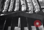 Image of egg breaker and separator machine Modesto California USA, 1932, second 55 stock footage video 65675032518