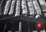 Image of egg breaker and separator machine Modesto California USA, 1932, second 56 stock footage video 65675032518