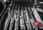 Image of egg breaker and separator machine Modesto California USA, 1932, second 60 stock footage video 65675032518