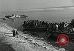 Image of Korean refugees ferrying across river Pyongyang North Korea, 1950, second 6 stock footage video 65675032638