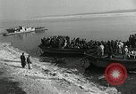 Image of Korean refugees ferrying across river Pyongyang North Korea, 1950, second 10 stock footage video 65675032638
