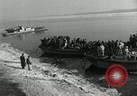 Image of Korean refugees ferrying across river Pyongyang North Korea, 1950, second 11 stock footage video 65675032638