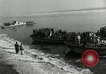 Image of Korean refugees ferrying across river Pyongyang North Korea, 1950, second 15 stock footage video 65675032638